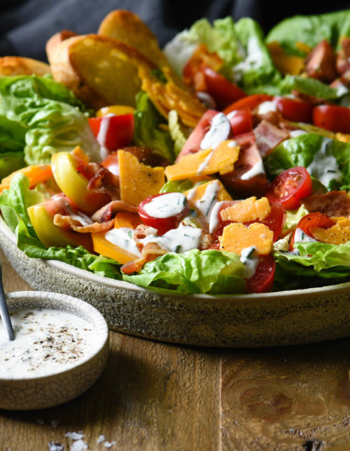 Turn a classic summer sandwich into a dinner-worthy salad with thisBLT Salad with Aged Cheddar. Drizzle with easy homemade buttermilk-chive dressing!   foxeslovelemons.com