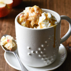 Craving a sweet treat but don't want to spend a lot of time in the kitchen? Use pantry ingredients and this Caramel Apple Mug Cake recipe to make two perfect portions of cake in your microwave. | foxeslovelemons.com