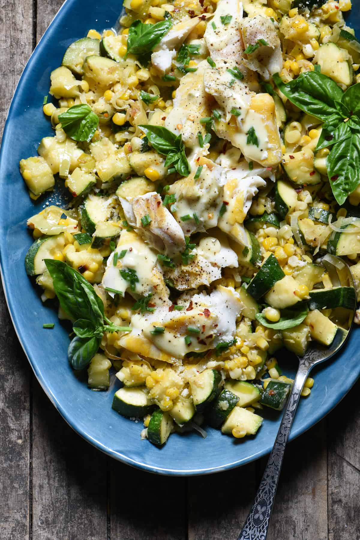Summer is served on a platter in this Parmesan Corn & Zucchini Sauté with Haddock recipe. Learn how to make a fast, easy vegetable sauté that you'll come back to again and again all summer long. Top it with fish or your favorite protein to make it a complete meal! | foxeslovelemons.com