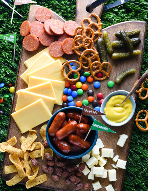 Keep your football parties delicious this fall with a platter piled high with sweet and salty snacks. Fans of all ages will enjoy this Tailgate Cheese Board!   foxeslovelemons.com