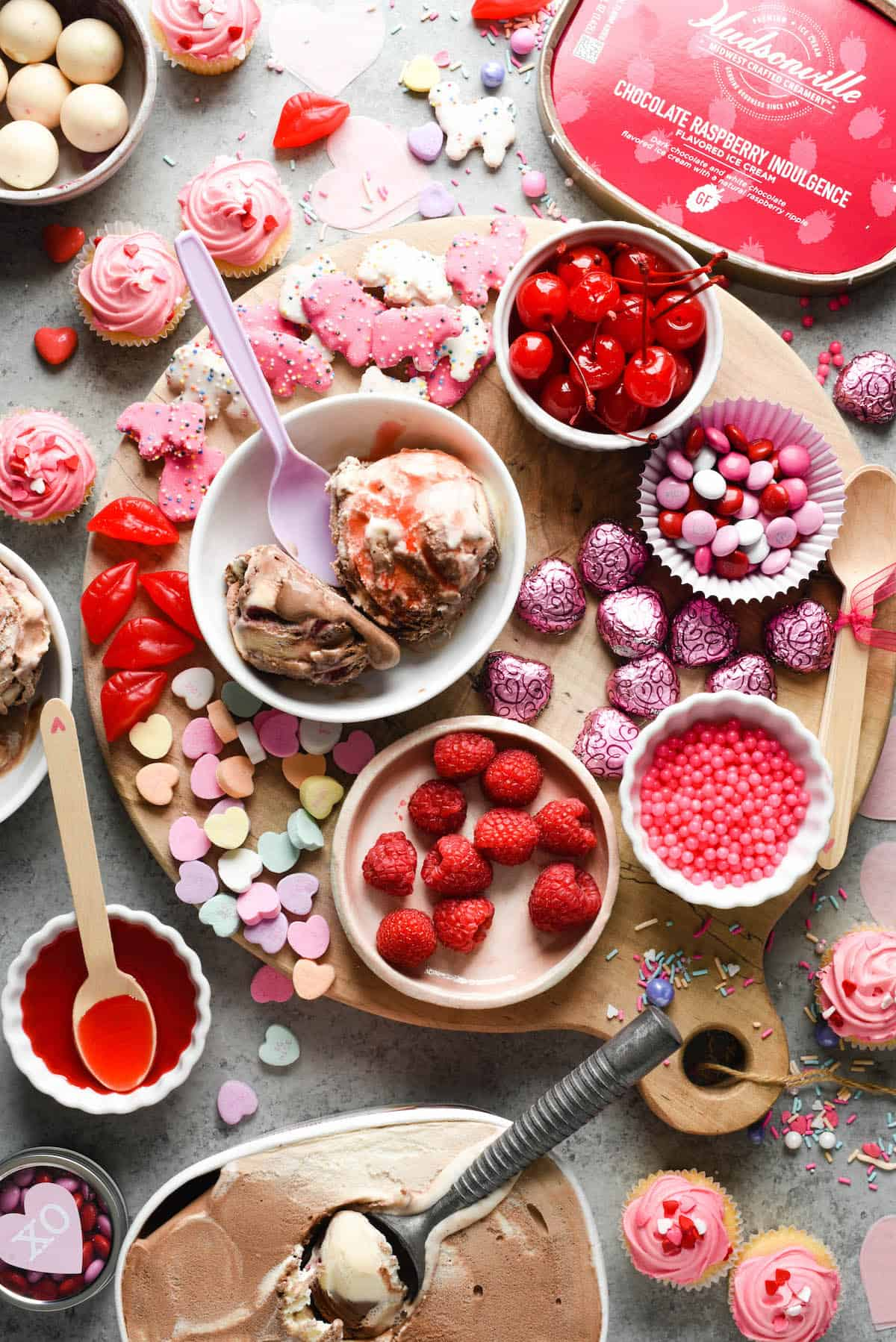 Make the holiday extra sweet with this dreamy Valentine's Day Dessert Board featuring ice cream, fruit, candies, chocolate and sprinkles! | foxeslovelemons.com