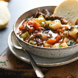 This Crockpot Vegetable Beef Soup is a simple, comforting and delicious Midwestern classic. A hearty meat and potatoes dinner in a bowl, this soup simmers to perfection while you're at work! | foxeslovelemons.com
