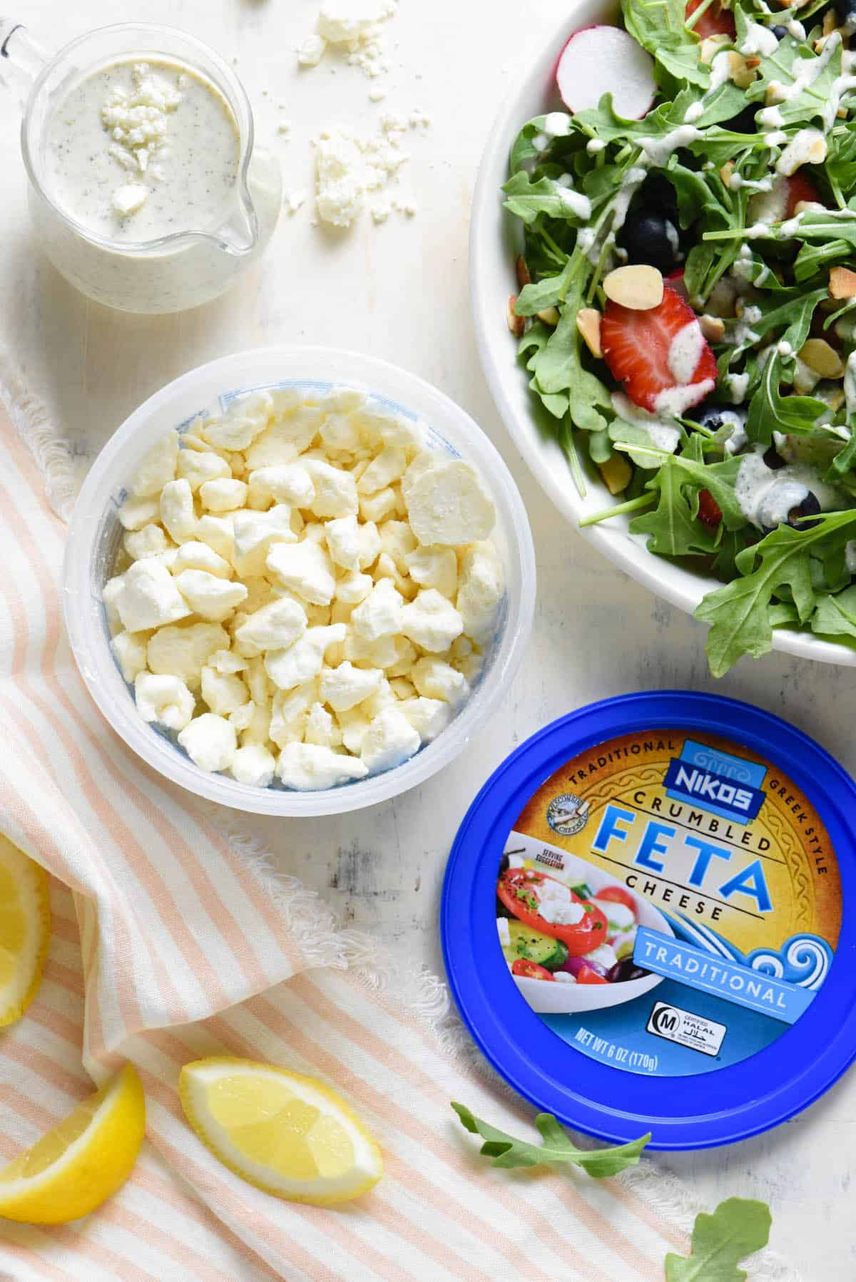 Take your salad game up a notch with this quick and easy homemade Creamy Lemon Feta Dressing. Use it to dress greens or pasta salad, add some pizazz to grilled chicken, or serve as a veggie dip. | foxeslovelemons.com