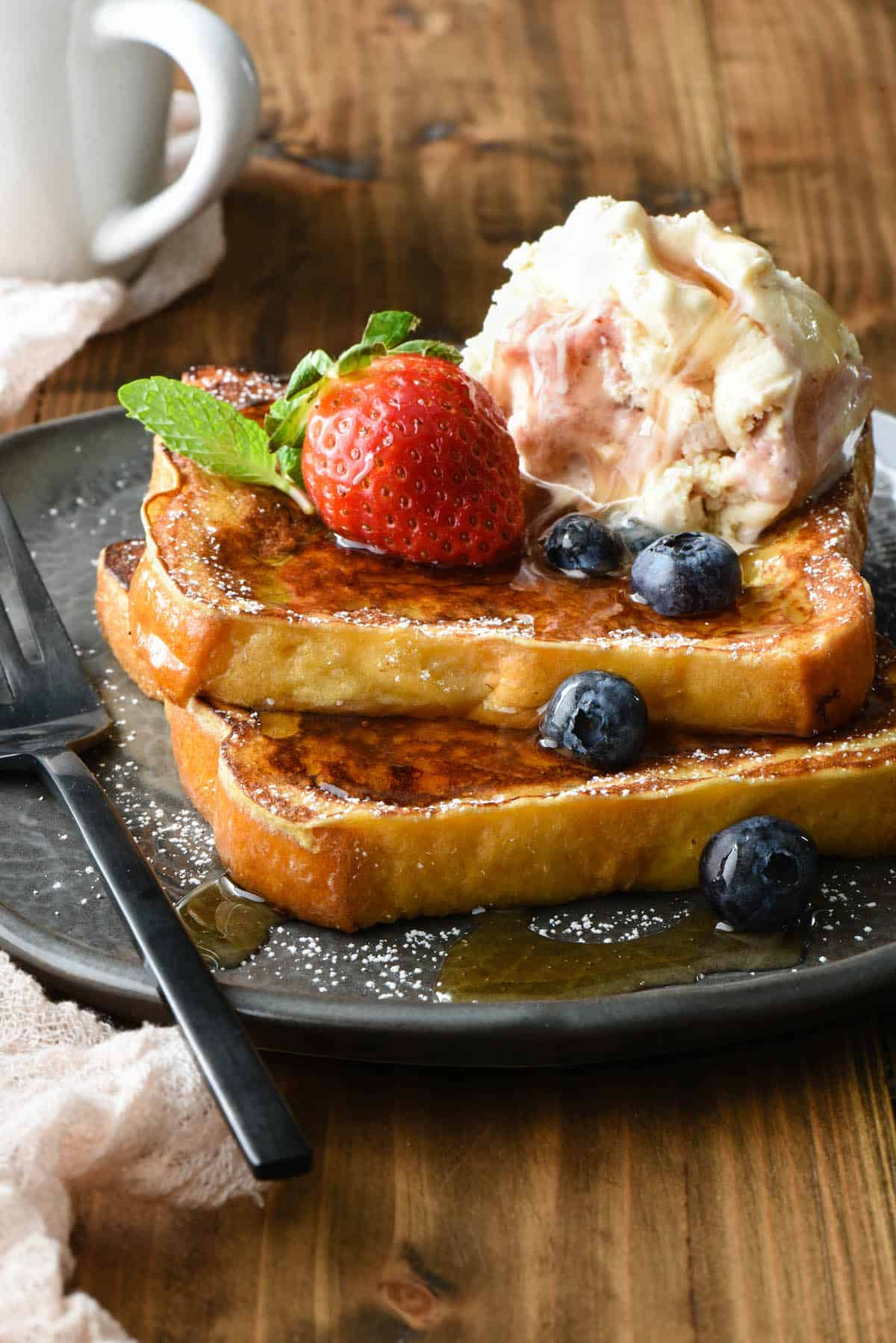 This Brioche French Toast is made with a secret ingredient! This easy-to-follow recipe makes a simple and sweet breakfast treat the whole family will love. | foxeslovelemons.com