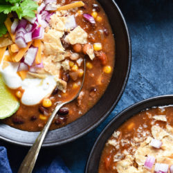 This Crockpot Taco Soup recipe comes together in just a few minutes. Includes instructions for making a large batch and freezing some for another meal, as well as a smaller batch. | foxeslovelemons.com
