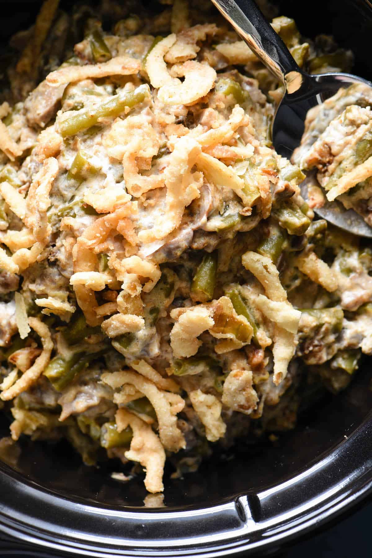 This Crockpot Green Bean Casserole is made with fresh beans and doesn't use canned soup. It's a yummy and easy upgrade to a classic dish, and doesn't take up oven space for a holiday meal! | foxeslovelemons.com