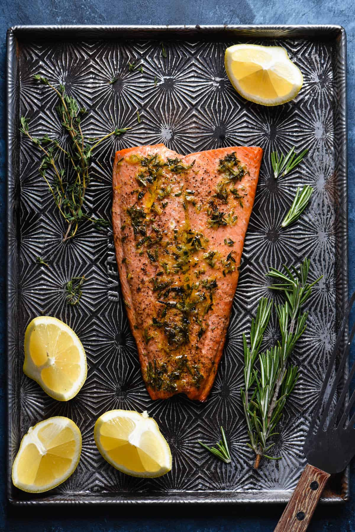 This Lemon Herb Baked Sockeye Salmon recipe is a foolproof way to prepare seafood at home. 5 ingredients + 5 minute prep time! | foxeslovelemons.com