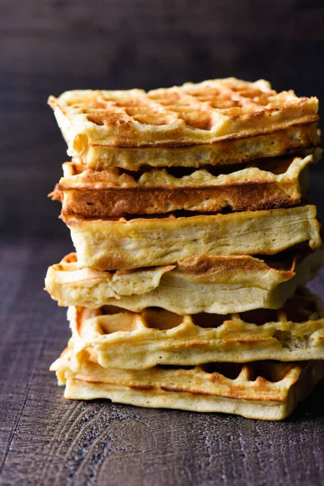 Stack of golden brown, square Belgian waffles.