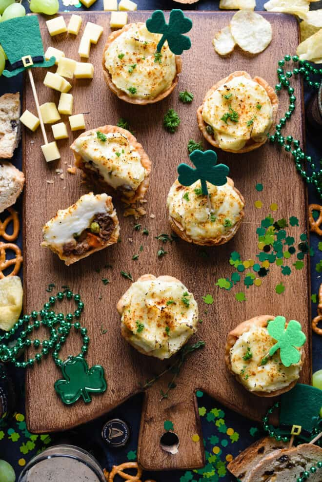 St. Patrick's Day party table featuring shepherd's pie muffins.