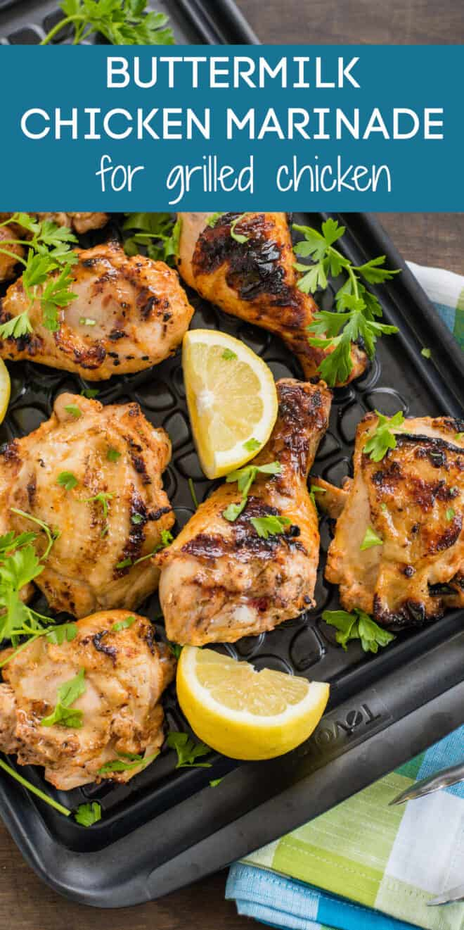 Image of black plastic tray of buttermilk marinated grilled chicken garnished with parsley and lemon, with overlay: BUTTERMILK CHICKEN MARINADE with grilled chicken.