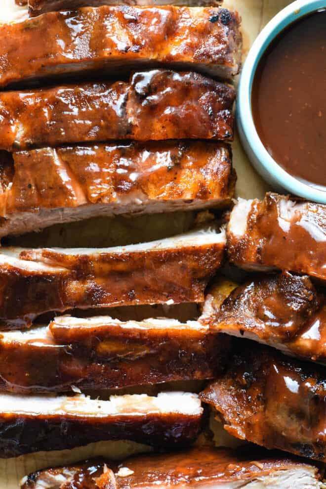 Crock pot ribs cut up and brushed with barbecue sauce.