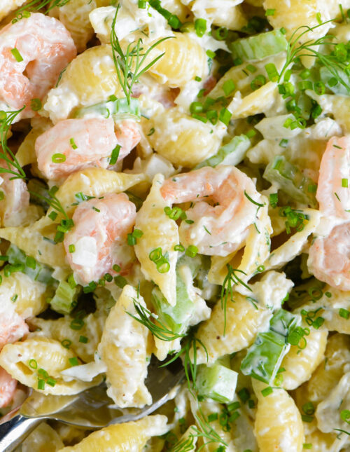 Creamy shell pasta noodles with shrimp, crab, celery and herbs.