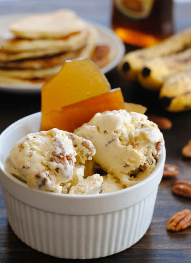 Large white ramekin filled with chunky homemade ice cream and maple brittle.
