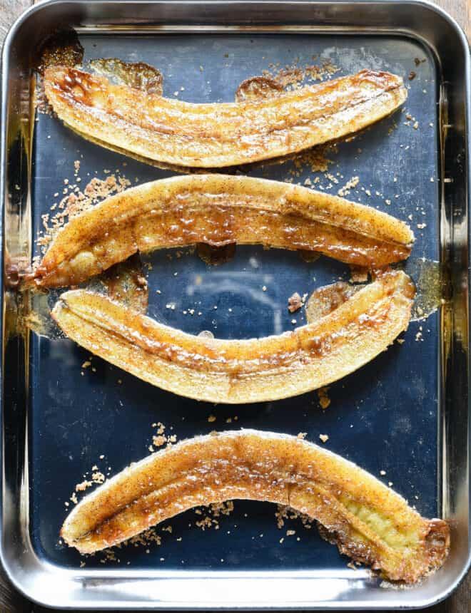 Small metal pan with 4 baked banana halves.