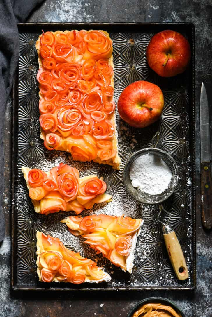 """Tart made with peanut butter custard and apple """"rose"""" on vintage baking pan."""
