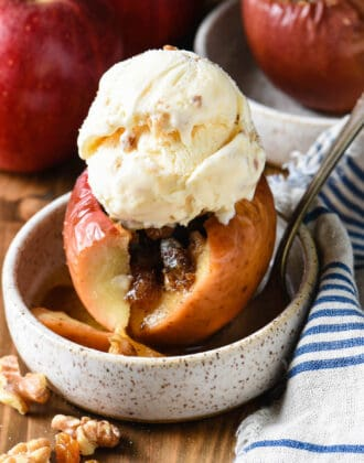 Baked apple filled with walnut filling and topped with ice cream.
