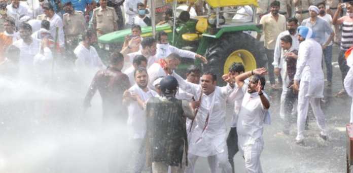 Indian Youth Congress water cannoned by Haryana police to stop the rally