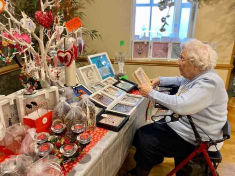 Resident browsing through Christmas Fayre at Care Home in Hitchin