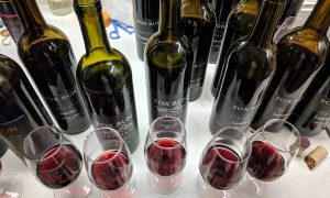 Several open bottles of wine during a library tasting