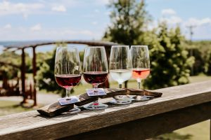 Wine flight on the front deck overlooking the gate at Fox Run