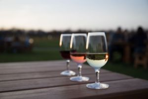 3 glasses of wine on outdoor picnic table at Fox Run