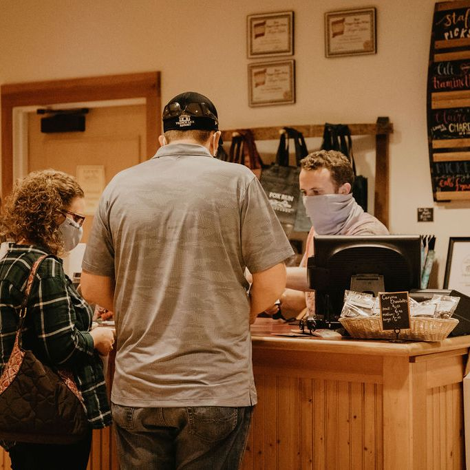Staff at tasting room registers cashing customers out
