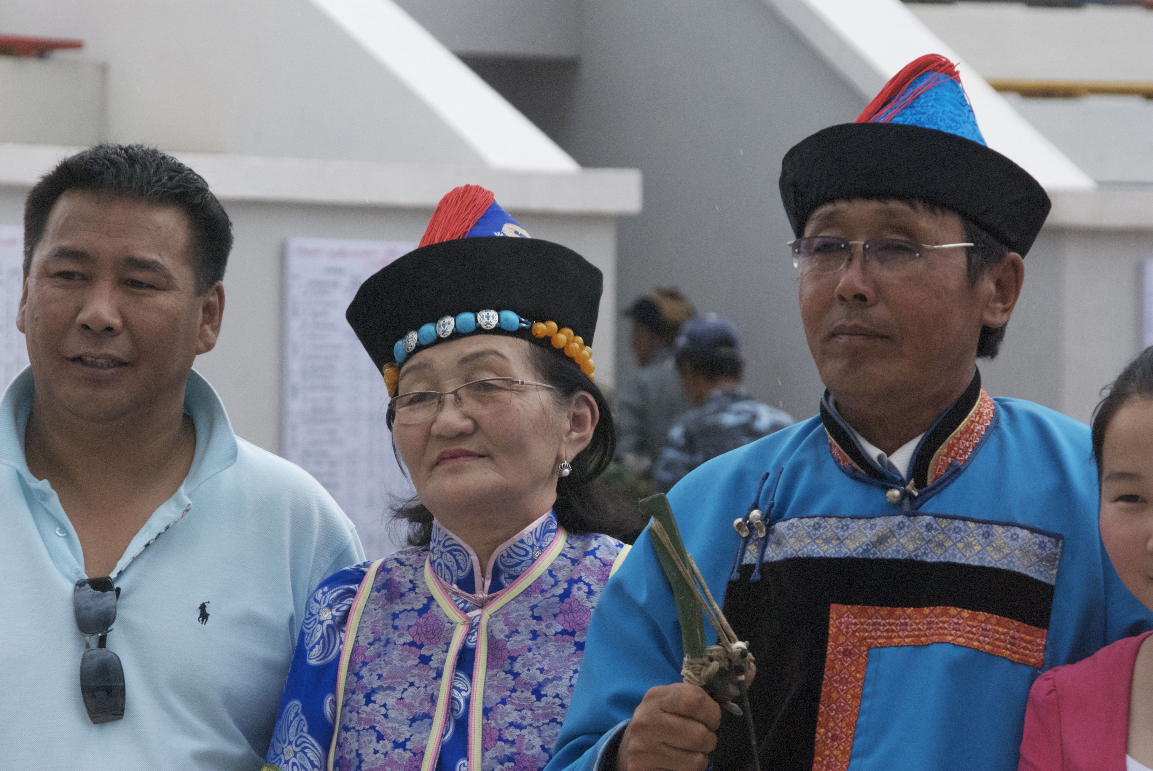 Winning archer, his wife and a fan