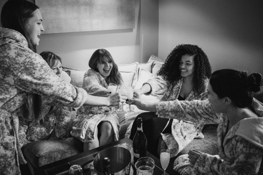 Bridal prep drinks in dressing gowns | Wood Hall Hotel