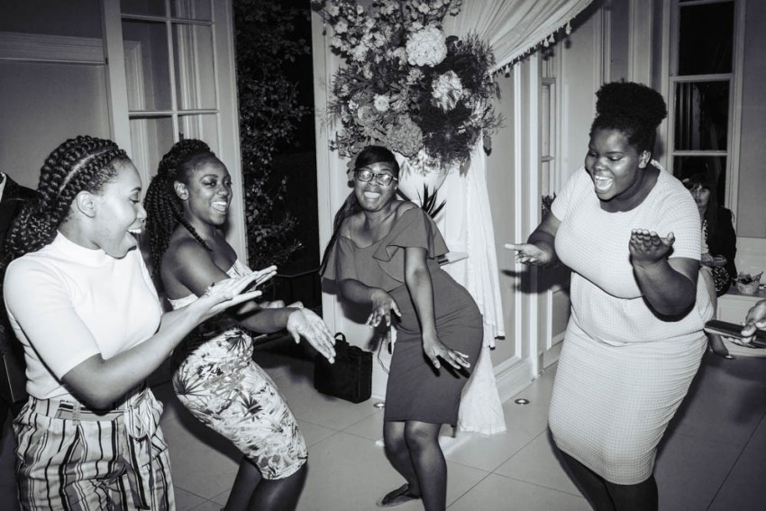 Documentary wedding photography | guests singing and dancing
