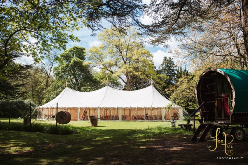 Markington Hall wedding marquee and vintage caravan for glamping.