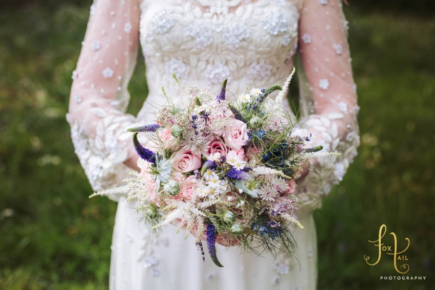 Markington Hall wedding photography of bridal bouquet with pink roses. North Yorkshire.