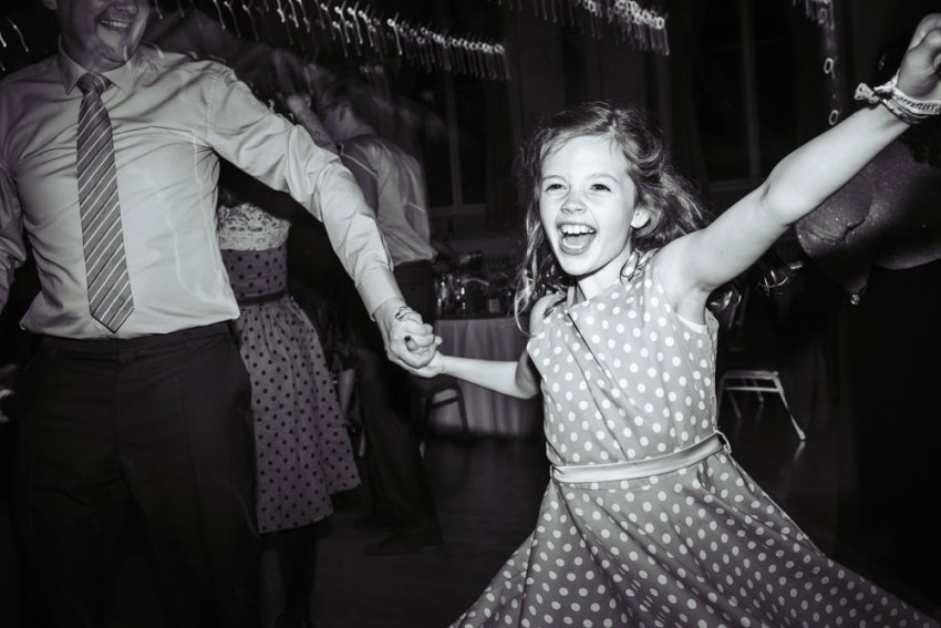 Young girl dances to the ceilidh band.