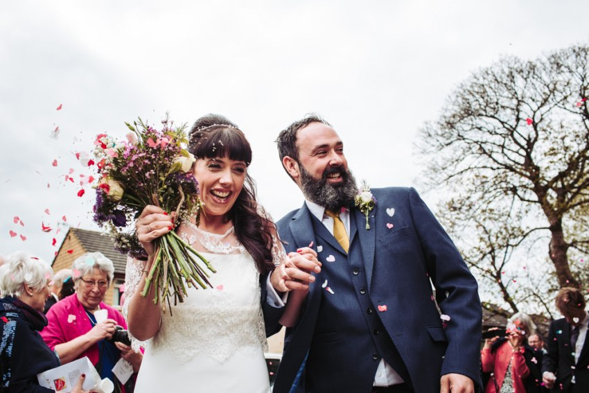 Victoria Hall Saltaire wedding photographer. Confetti throwing over bride and groom.