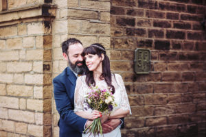 Victoria Hall wedding photographer Yorkshire. Portrait of bride and groom on streets of Saltaire .