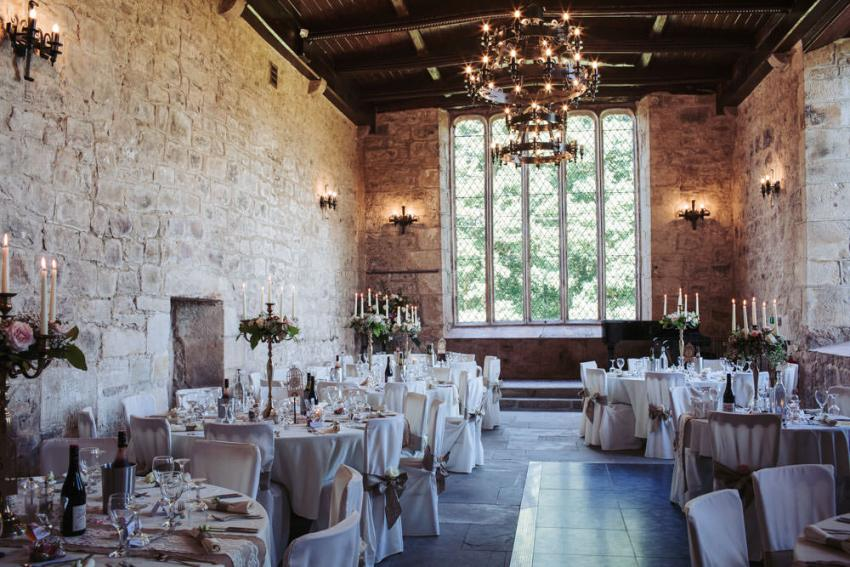 North Yorkshire medieval wedding venue. Priests House at Barden Tower wedding near Bolton Abbey. Wedding breakfast tables.