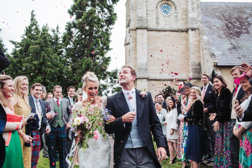 Confetti throwing at All Saints Church wedding in Staveley, York, Yorkshire.