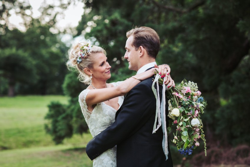 Natural wedding photography by Harroagte wedding photographer UK. Bride and groom portrait.