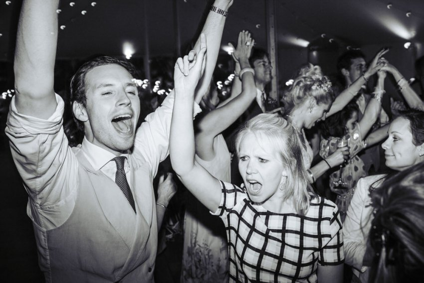 Guests sing their hearts out on the dance floor.