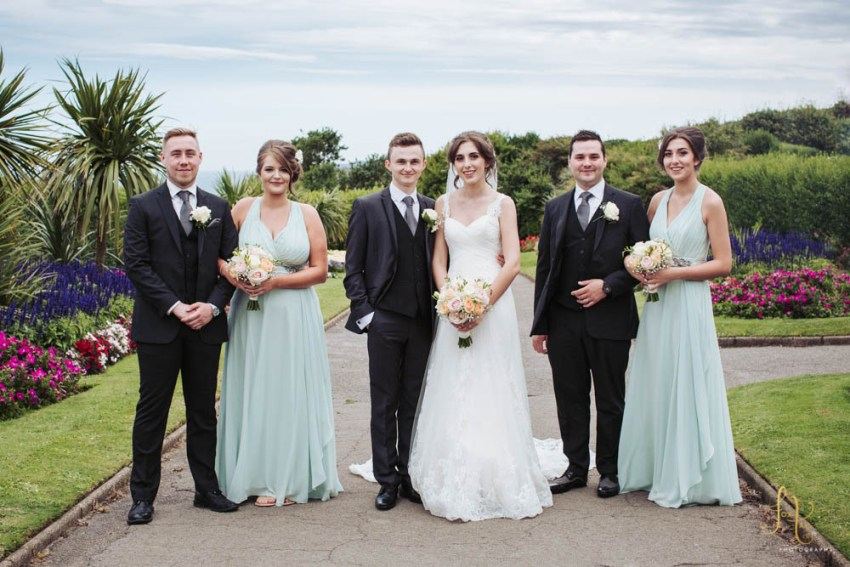 Scarborough sea front wedding photography. Group photo with bridesmaids in pastel green Jenny Packham dresses.