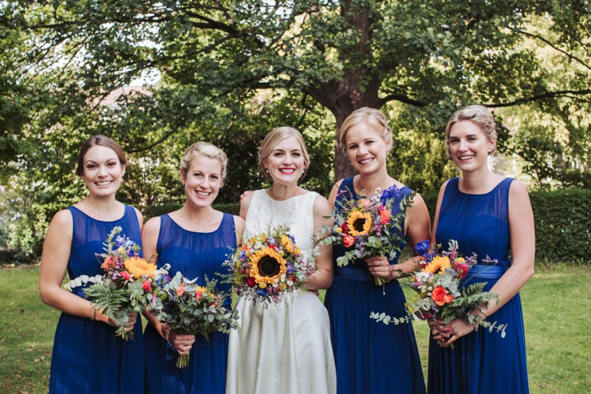 Bridesmaids in royal blue and bride at St. Andrews Church wedding, Sheffield.