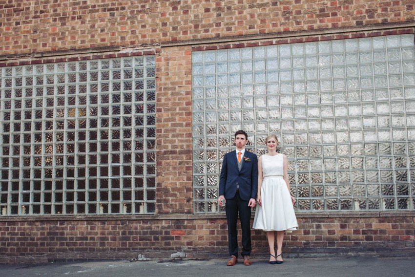 Trafalgar Warehouse wedding photography Sheffield Yorkshire. Bride and groom stood outside windows of Trafalgar Warehouse.