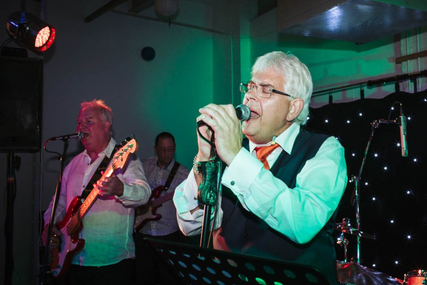 Bride's dad sings with band.