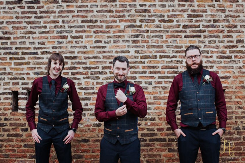 Groom and groomsmen in burgundy red shirts grey waistcoats