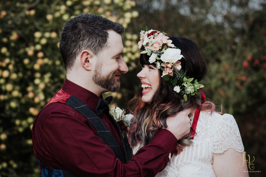 Bride and groom laughing. Natural wedding photography.
