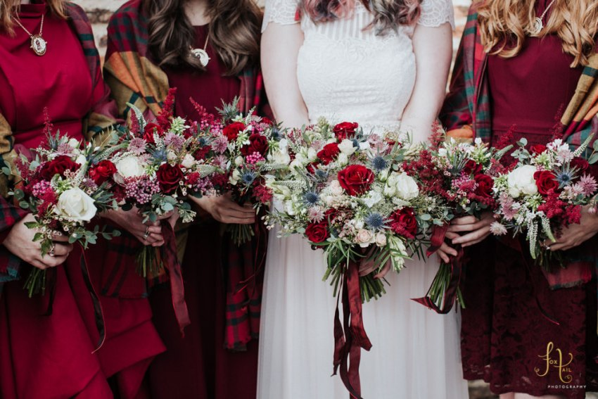 Red wedding bouquets Yorkshire. Red roses and blue thistles.