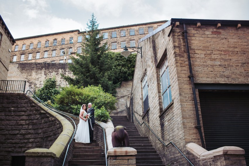 Industrial mill wedding venue backdrop. Portrait of bride and groom, the Arches in Yorkshire.