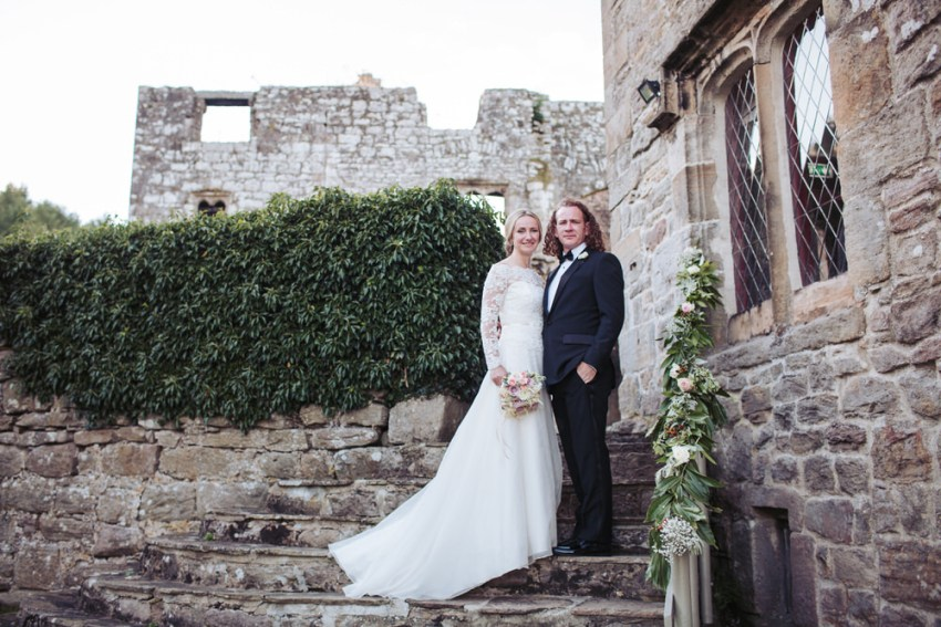 Barden Tower Priest house wedding photography Bolton Abbey estate, Yorkshire. Bride and groom on steps.