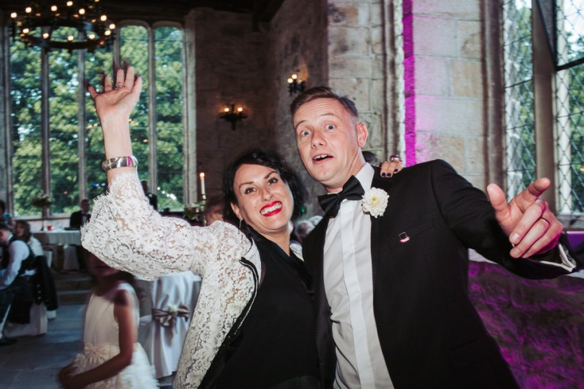 Couple dancing and posing for camera.