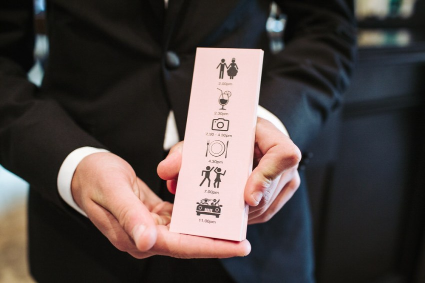 Cute bookmark style wedding timeline flyer for guests, in pink with pictures of activities for the day.