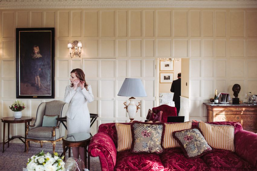 Bride and groom prep in the Astor suite at Cliveden House hotel.